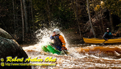 Open canoeist solo man or OC1 blasting through the breaking waves of Gilmores Mistake Rapids at 1400 frigid CFS or 25 inches on Section 3 of the wild Wolf River within Langlade County (USA WI White Lake; Obst FAV Photos 2013 Nikon D300s Daily Best Obst Image 5249)